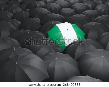 Umbrella with flag of nigeria over black umbrellas - stock photo