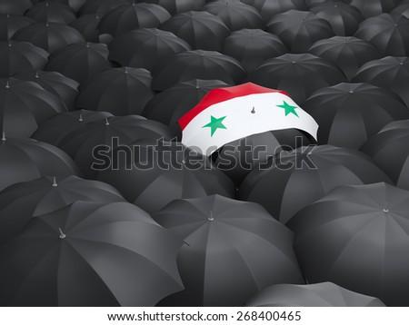 Umbrella with flag of syria over black umbrellas - stock photo
