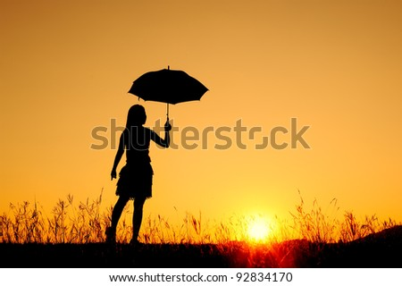 Umbrella woman jump and sunset silhouett