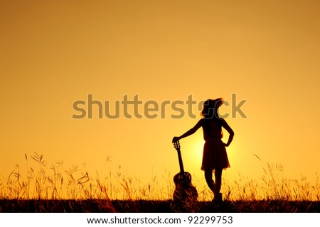 Umbrella woman jump and sunset silhouette - stock photo