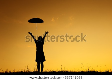 Umbrella woman stand and sunset silhouette with copy space.
