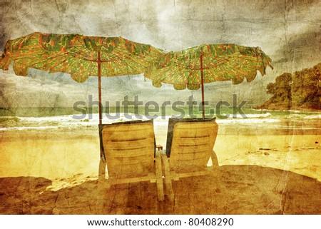 Umbrellas at the sand tropical beach in grunge and retro style . Andaman sea. Phuket island. Kingdom Thailand - stock photo