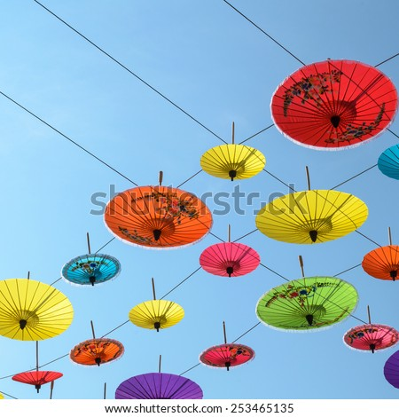 Umbrellas, handmade on sky in Chiang Mai, Thailand. - stock photo