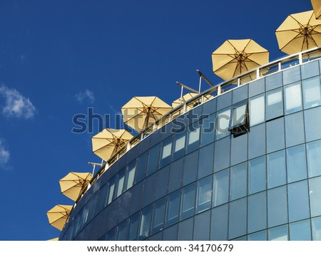 Umbrellas of street cafe on the office building roof in Vienna, Austria