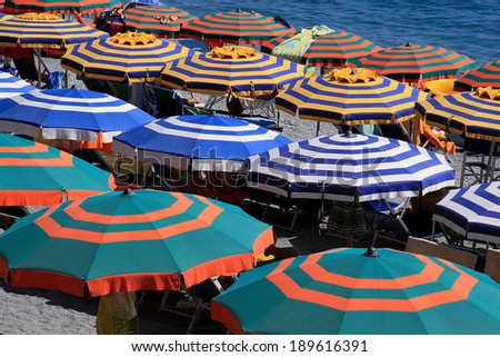 umbrellas on the beach - stock photo