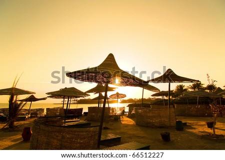 Umbrellas Paradise Sunset - stock photo