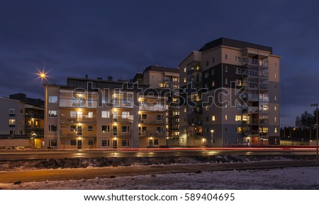 UMEA, SWEDEN ON FEBRUARY 14. View of a modern suburban settlement, buildings, street, walkway, traffic on February 14, 2017 in Umea, Sweden.