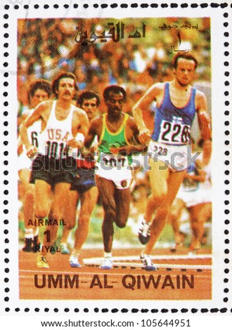 UMM AL-QUWAIN - CIRCA 1972: a stamp printed in the Umm al-Quwain shows Sprint, Running, Athletics, Summer Olympics, Munich 1972, circa 1972 - stock photo