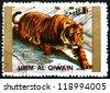 UMM AL-QUWAIN - CIRCA 1972: a stamp printed in the Umm al-Quwain shows Tiger, Animal, circa 1972 - stock photo