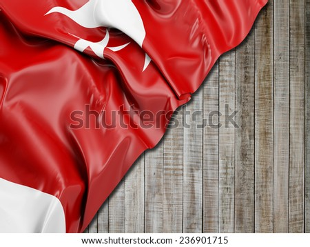 Umm al-Quwain Flag with vertical wood - stock photo