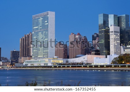UN Headquarters from East River, early morning, Manhattan, New York - stock photo
