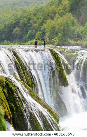 UNA, BOSNIA AND HERZEGOVINA - AUGUST 10, 2016: Man jumps from a waterfall, and preparing for rafting on August 10, 2016 near Bihac
