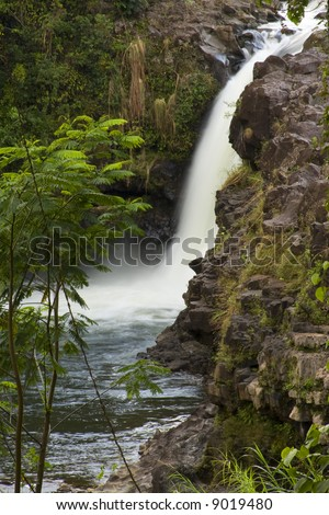 Unamed waterfall on the Wialuki River as seen from the property of OK Farms, Hilo Hawaii - stock photo