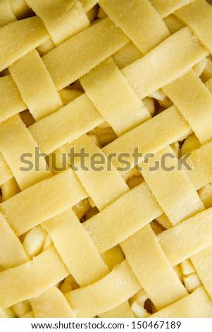 Unbaked lattice top of apple pie - stock photo