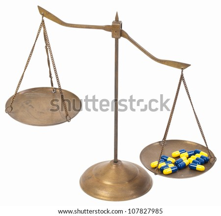 unbalance of drug golden brass scales of justice on white. - stock photo