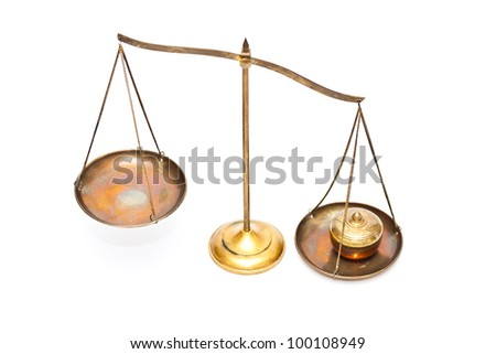 unbalance of golden brass scales of justice on white - stock photo