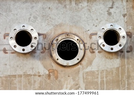 unbolted flanges of a machine - stock photo