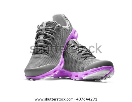 Unbranded modern purple sneakers isolated on a white background. - stock photo
