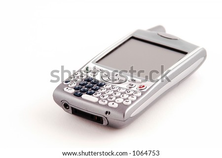 unbranded PDA phone, focus is on the 5-way navigator key and the keypad. Intentional selective focus. - stock photo
