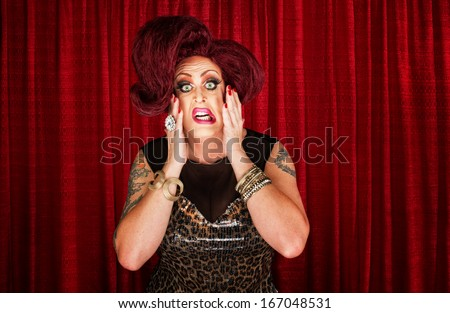 Uncertain drag queen with hands on face - stock photo