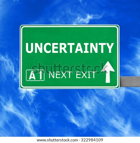 UNCERTAINTY road sign against clear blue sky - stock photo