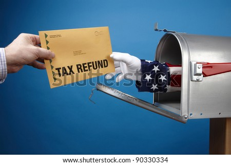 Uncle Sam's arm comes through mailbox to give/take tax refund, includes space for copy