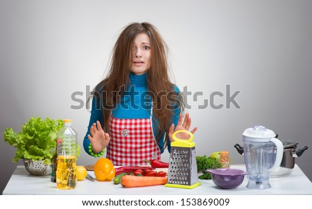 Uncombed depressive woman in the kitchen  - stock photo