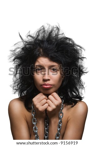 Uncombed suffering  black-haired girl in chains on a white background - stock photo