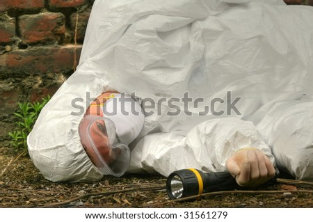 unconscious worker lying on the ground - stock photo