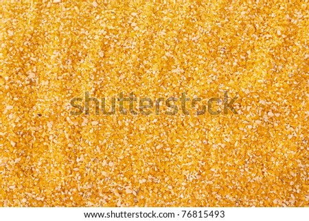 Uncoocked hominy grits  as texture - stock photo
