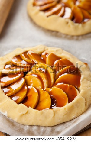 Uncooked apple pies with caramel sause - stock photo