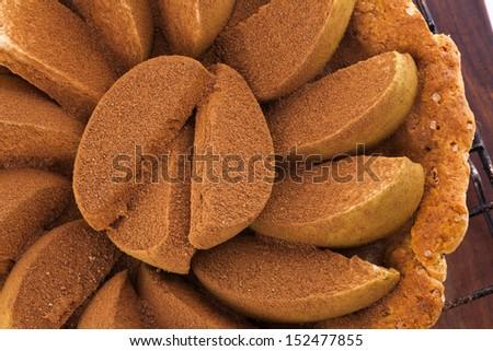 Uncooked apple pies with cinnamon - stock photo