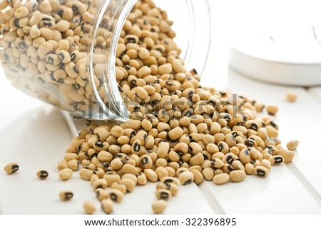 uncooked beans on kitchen table - stock photo