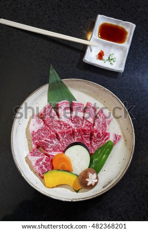 uncooked beef of ishigaki top view,close up with black background