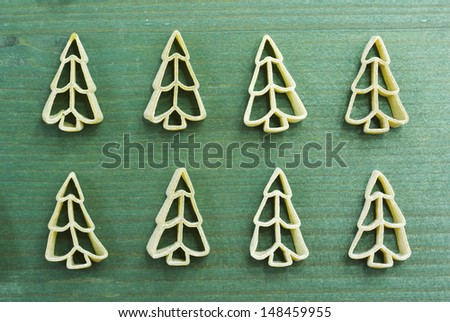 uncooked christmas tree shape pasta on wooden table