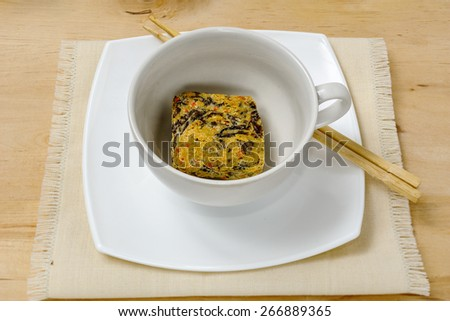 Uncooked dry instant Noodle in white bowl with chopsticks - stock photo