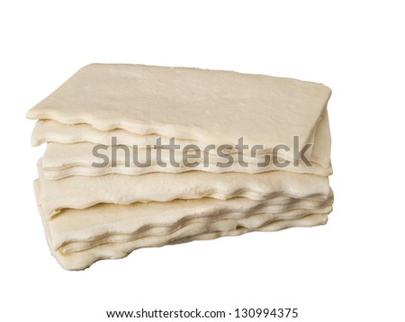 Uncooked flaky pastry slices isolated on white background - stock photo