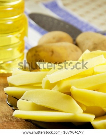 Uncooked fresh potato cut in strips . - stock photo