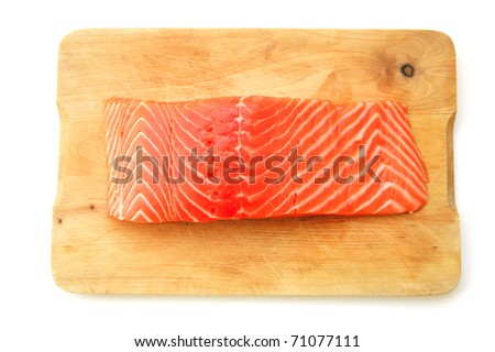 uncooked fresh salmon fish piece served over wooden board isolated on white background . shallow dof - stock photo