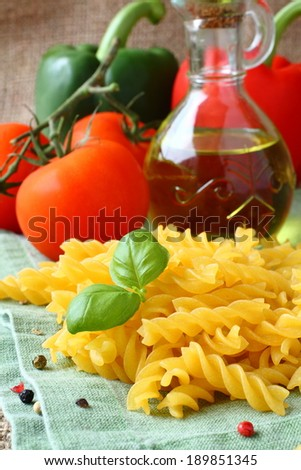Uncooked gluten free fusilli pasta from blend of corn and rice flour - stock photo