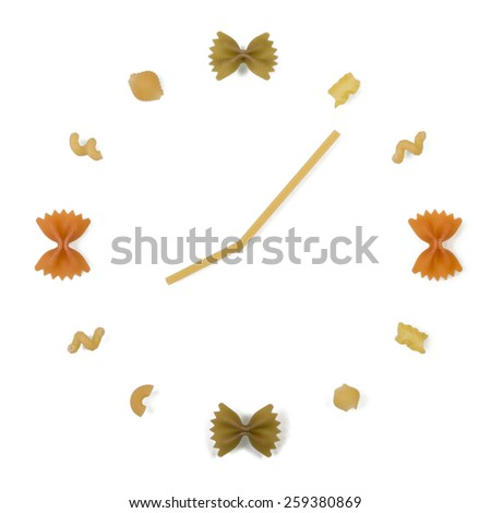 Uncooked italian pasta in clock shape on white background - stock photo