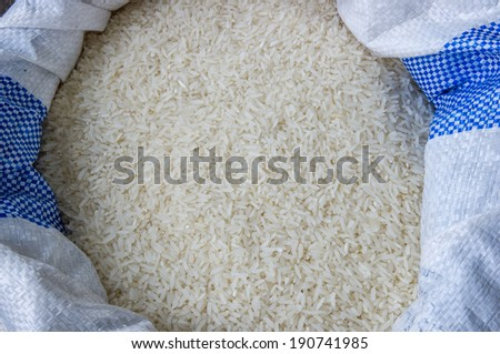 Uncooked jasmine rice in a bag. - stock photo