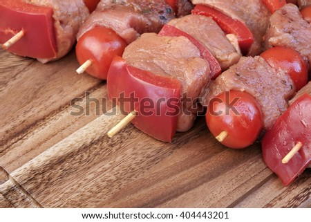 Uncooked Marinated And Rubbed Shish Kebabs From Pork Tenderloin On Skewers Ready For Grilling In BBQ - stock photo