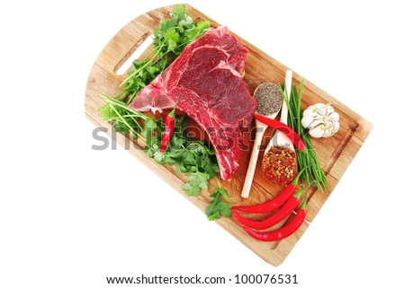 uncooked meat : raw fresh beef pork rib ready to cooking with garlic and red hot pepper over wood isolated over white background - stock photo