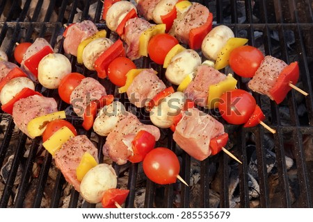 Uncooked Mixed Pork Meat And Vegetables Kebabs On The Hot Barbecue Charcoal Grill - stock photo