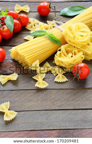 uncooked pasta and ingredients, food closeup - stock photo