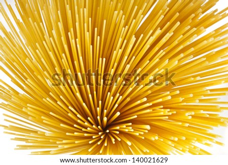 Uncooked pasta spaghetti macaroni, Top view, isolated on white background - stock photo