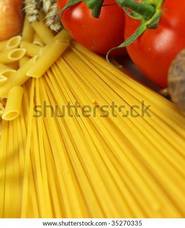 Uncooked pasta with ingredients - stock photo