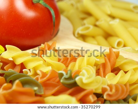 Uncooked pasta with tomato