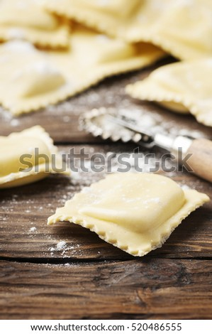 Uncooked ravioli on the wooden table, selective focus
